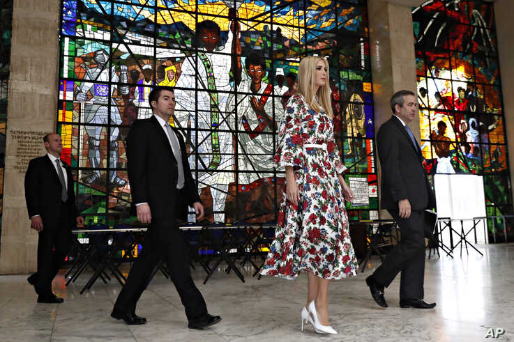 Ivanka Trump leaves the African Women's Empowerment Dialogue, with Overseas Private Investment Corp. acting CEO David Bohigian, right, and security staff, April 15, 2019, at the U.N. Economic Commission for Africa building in Addis Ababa, Ethiopia.