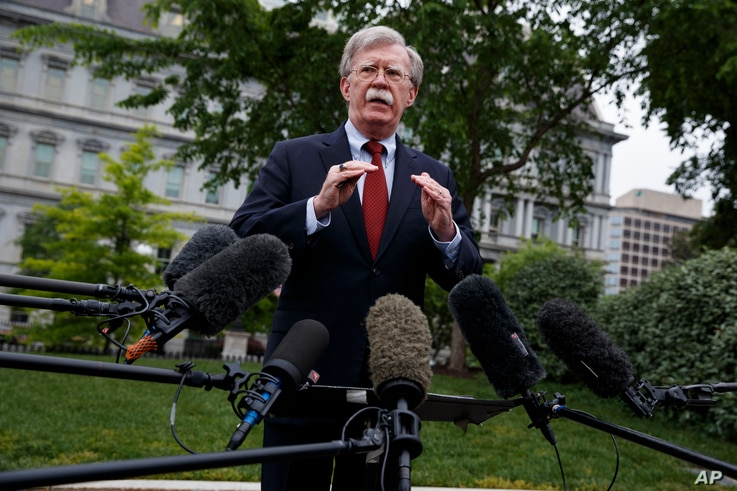 National security adviser John Bolton talks to reporters about Venezuela, outside the White House, May 1, 2019