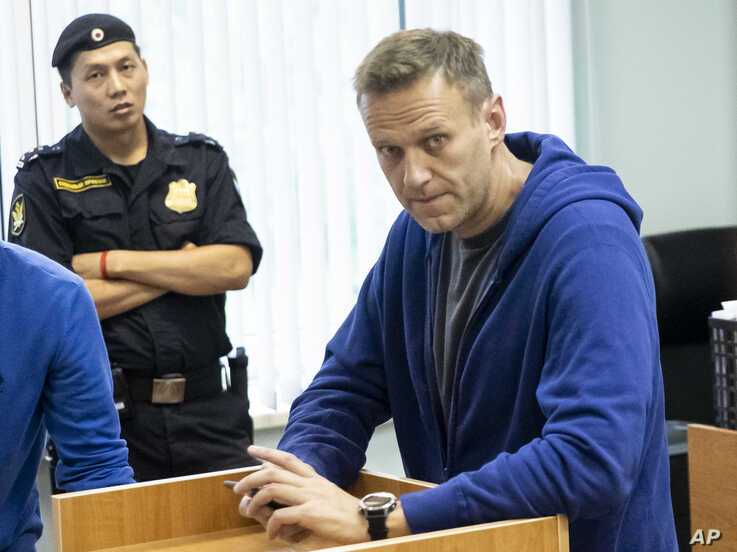 Alexei Navalny, Russia's most prominent opposition figure, who has been detained by police and charged with unlawfully organizing a public gathering, sits in a court room in Moscow, July 24, 2019.