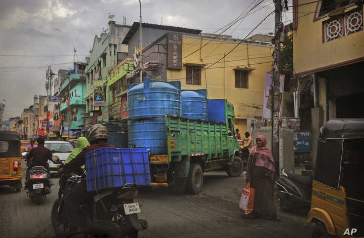 In this July 18, 2019, photo, a water truck carrying drinking water arrives at a locality in Chennai, in the Southern Indian state of Tamil Nadu.