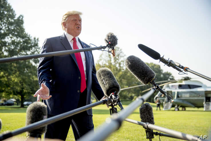 President Donald Trump speaks to members of the media on the South Lawn of the White House in Washington, Aug. 7, 2019.