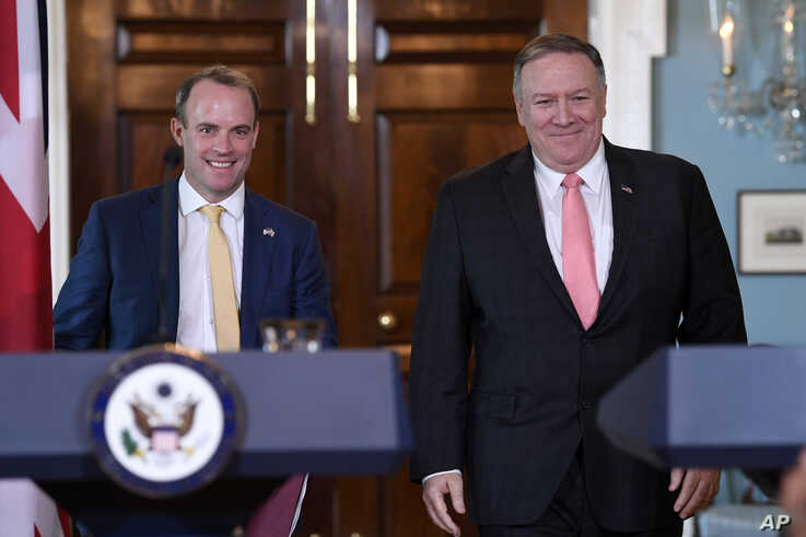 FILE - Secretary of State Mike Pompeo, right, walks with Britain's Foreign Secretary Dominic Raab for a press availability at the State Department in Washington, Aug. 7, 2019.