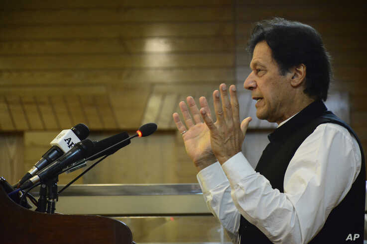 Pakistani Prime Minister Imran Khan addresses Kashmir's Legislative Assembly on the occasion of Pakistan's Independence Day, in Muzaffarabad, capital of Pakistani Kashmir, Aug. 14, 2019.