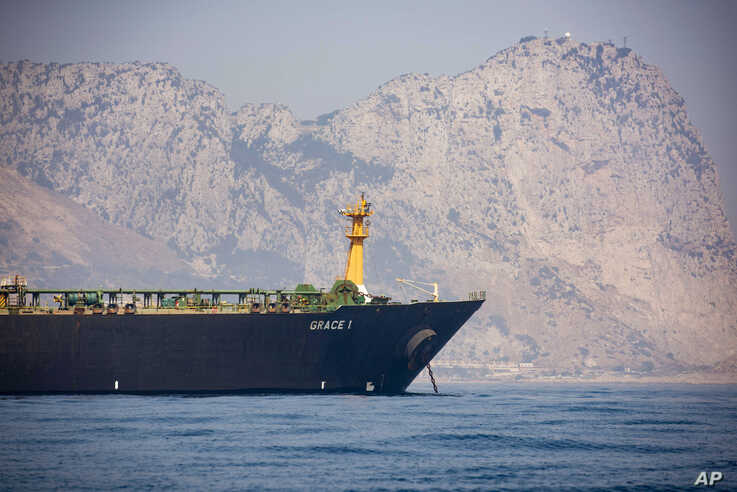 A view of the Grace 1 supertanker is seen backdropped by Gibraltar's Rock, as it stands at anchor in the British territory of Gibraltar, Aug. 15, 2019.