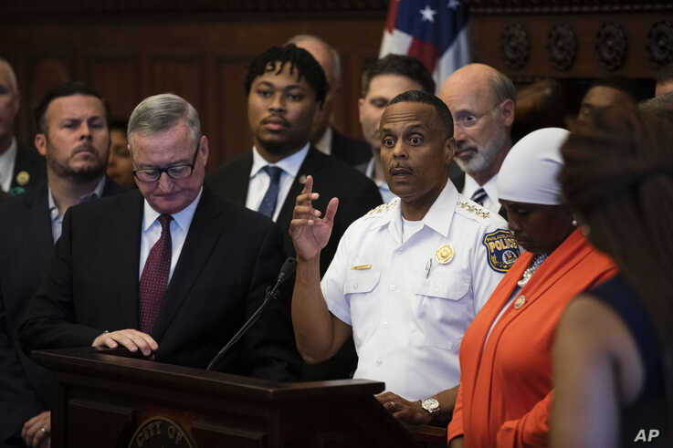 Philadelphia Police Commissioner Richard Ross, center right, speaks during a news conference at City Hall in Philadelphia, Aug. 15, 2019.