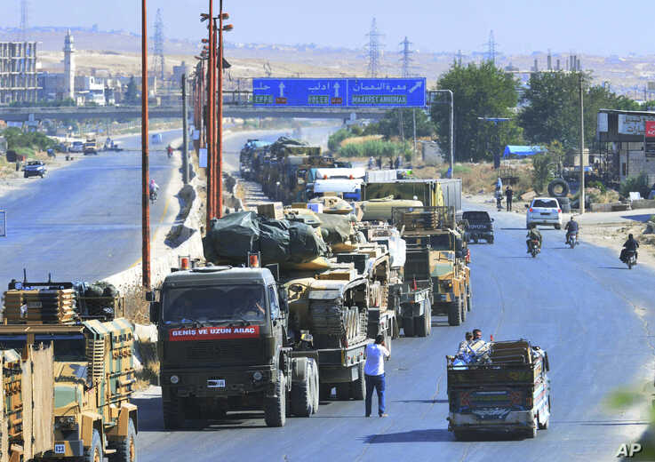 A Turkey Armed Forces convoy is seen at a highway between Maaret al-Numan and Khan Sheikhoun in Idlib province, Syria, Aug. 19, 2019.