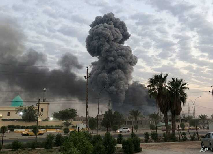 FILE - Plumes of smoke rise after an explosion at a military base southwest of Baghdad, Iraq, Aug. 12, 2019.