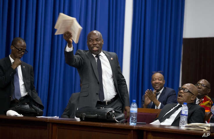 Lawmaker Jean Marcel Lumérant speaks in favor of starting impeachment proceedings against Haitian President Jovenel Moise, as lawmakers debate in Parliament in Port-au-Prince, Haiti, Wednesday, Aug. 21, 2019.