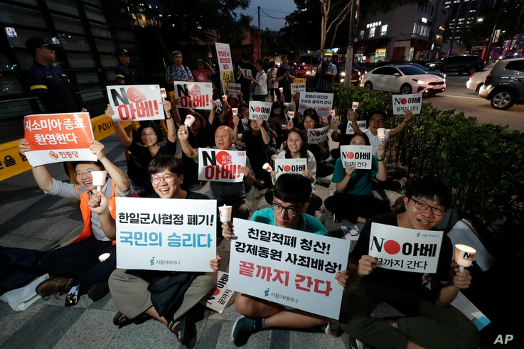 South Korean protesters react during a rally about the General Security of Military Information Agreement, or GSOMIA, in front of Japanese embassy in Seoul, South Korea, Thursday, Aug. 22, 2019.