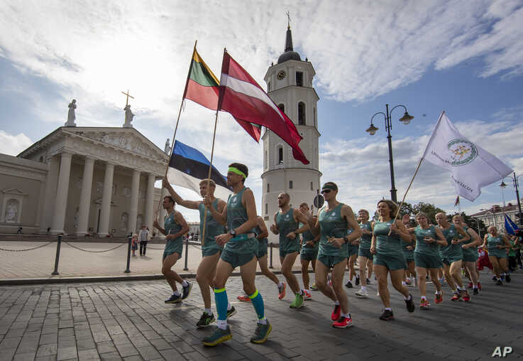 Lithuanian people take part in a traditional relay race Vilnius-Riga-Tallinn dedicated to the 30th anniversary of the Baltic Way