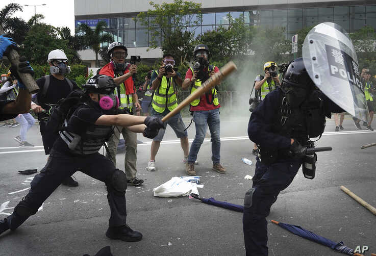 "Police and demonstrators clash in Hong Kong, Aug. 24, 2019. The city's pro-democracy protesters took to the streets again, this time to call for the removal of ""smart lampposts"" that raised fears of stepped-up surveillance."