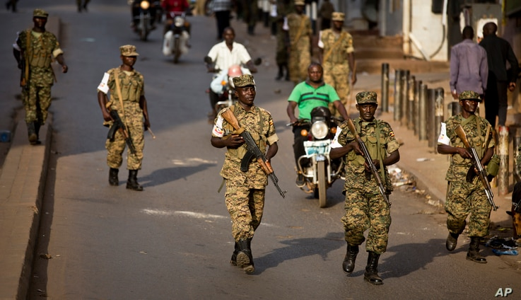 FILE - Ugandan army soldiers deploy, after the election result was announced, in downtown Kampala, Uganda, Feb. 20, 2016.