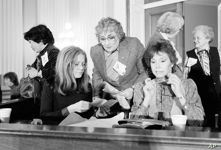 Women's rights activist Gloria Steinem, left, joins former congresswoman Bella Abzug, center, and actress Mary Tyler Moore, right, during a meeting of women's rights leaders on Capitol Hill in Washington, Feb. 4, 1981.