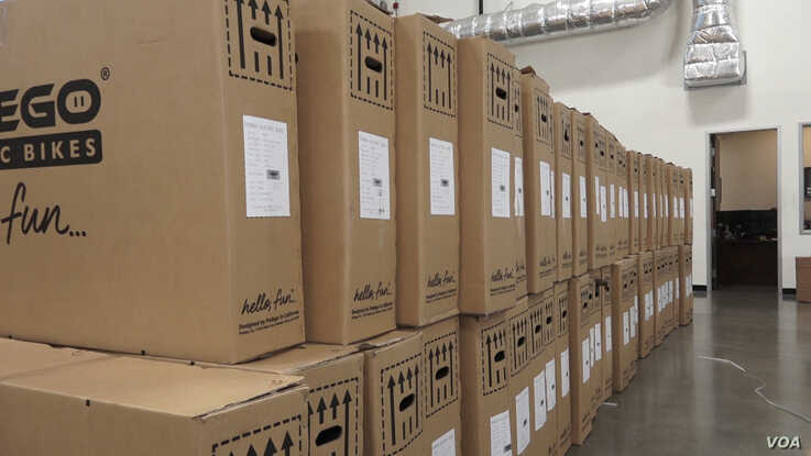 Boxes of bikes from Vietnam are stacked in the warehouse of Pedego Electric Bikes in Fountain Valley, California.  The bikes are