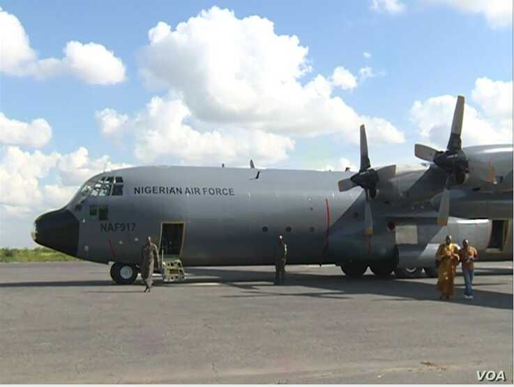 A Nigerian Air Force plane that will transport Nigerian refugees to Yola in Nigeria's Adamawa state waits in Maroua, Cameroon, A