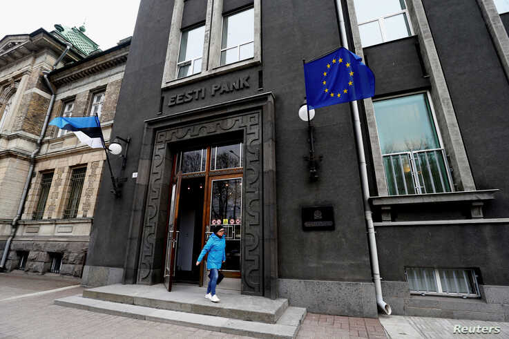A woman leaves Estonia's central bank in Tallinn, Estonia, March 25, 2019.