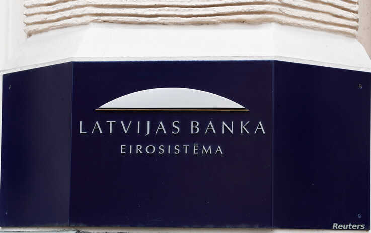 Latvian central bank sign is seen on the bank's headquarters in Riga, April 9, 2019.