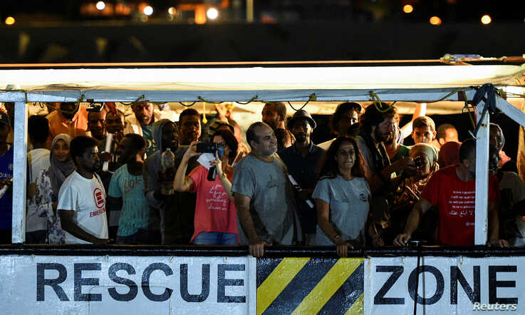 Spanish rescue ship Open Arms with migrants on board arrives in Lampedusa, Italy, Aug. 20, 2019.