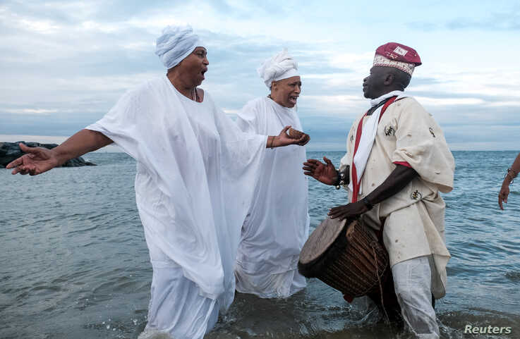Members of the Africa Queen Mothers participate in a sunrise service and spiritual cleansing ceremony in remembrance of the 400-year anniversary of the arrival of the first enslaved Africans in Virginia, in Hampton, Va., Aug. 24, 2019.