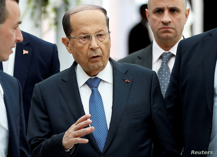 FILE - Lebanese President Michel Aoun gestures upon his arrival at Tunis-Carthage International Airport in Tunis, Tunisia, March 30, 2019.