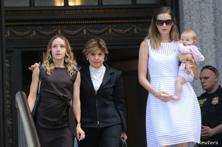 Gloria Allred, representing alleged victims of Jeffrey Epstein, walks with Teala Davies and an unidentified women and baby after the hearing in the criminal case against Epstein, at Federal Court in New York, Aug. 27, 2019.