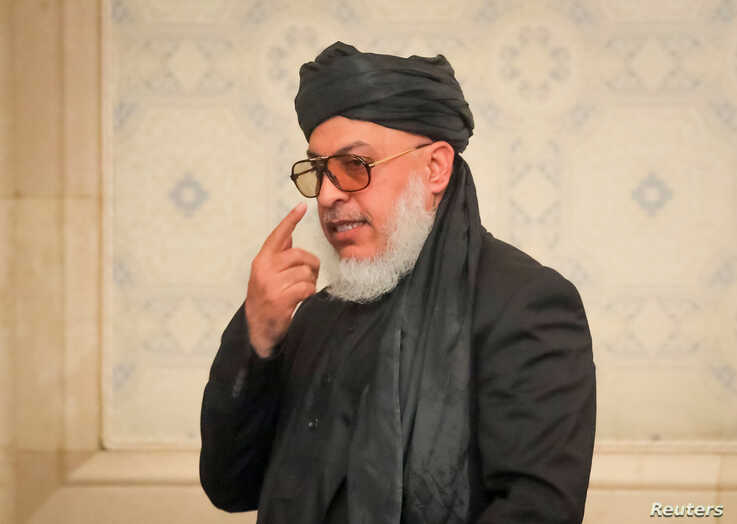 FILE - Taliban negotiator Sher Muhammad Abbas Stanekzai attends a conference arranged by the Afghan diaspora, in Moscow, Feb. 5,