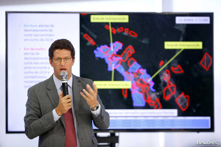 FILE - Brazil's Environment Minister Ricardo Salles speaks during a news conference at the Planalto Palace in Brasilia, Brazil, Aug. 1, 2019.