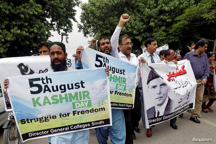 Demonstrators hold signs and chant slogans as they march in solidarity with the people of Kashmir, during a rally in Karachi, Pakistan, Aug. 5, 2019.