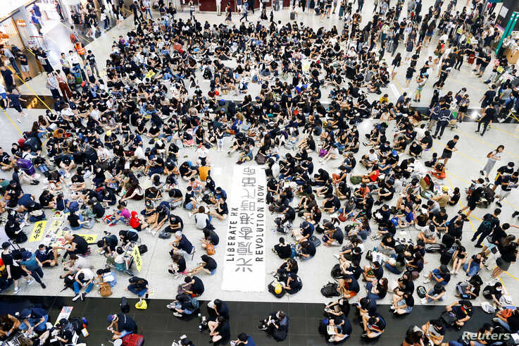 FILE - Anti-extradition bill demonstrators attend a protest at the arrival hall of Hong Kong Airport, China, Aug. 9, 2019.