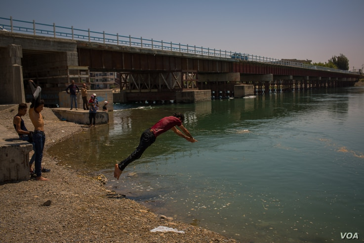 The new bridge over the Euphrates River was rebuilt and now links the two sides of Raqqa, Syria, Aug. 25, 2019. (Yan Boechat/VOA)