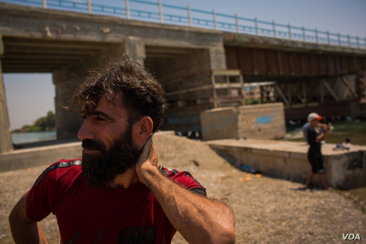 Abdullah, 33 years old and the father of five children, says he is still afraid of IS coming back to Raqqa, Syria, Aug. 25, 2019. (Yan Boechat/VOA)