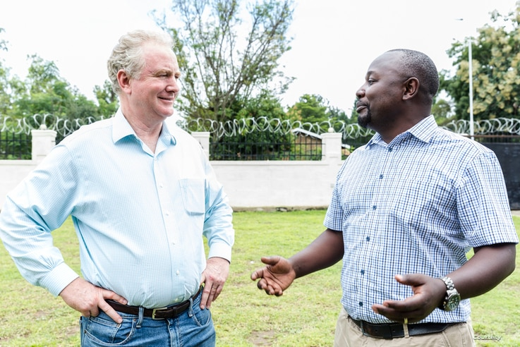 Senator Chris Van Hollen, left, walks with CARE President and CEO Michelle Nunn, while touring refugee settlements in Uganda, Aug. 14, 2019.