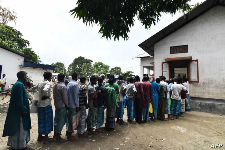 People stand in line to check for their names on the final list of the National Register of Citizens (NRC), in an office in Pavakati village of Morigoan district, in India's northeastern state of Assam, Aug. 31, 2019.