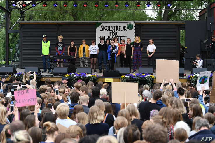 FILE - Greta Thunberg, center, the 16-year-old Swedish climate activist, speaks at an event during a global day of student protests aiming to spark world leaders into action on climate change in Stockholm, Sweden, May 24, 2019.