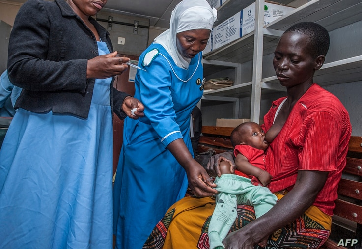 A health worker prepares to vaccinate a child against malaria, at Mitundu Community Hospital, in Malawi's capital of Lilongwe, April 23, 2019.
