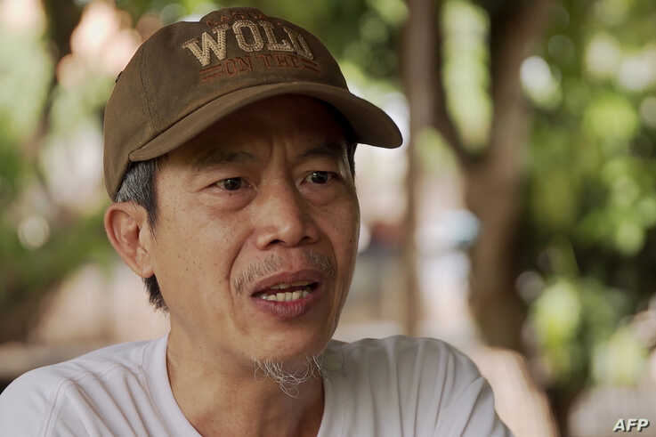 """This screen grab from video footage taken on July 9, 2019 shows Faiyen band member Trairong """"Khunthong"""" Sinseubpol speaking during an interview at an undisclosed location in Laos."""
