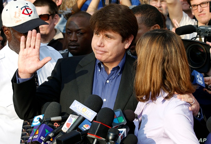 Former Illinois Governor Rod Blagojevich, with his wife Patti at his side, speaks to the media in Chicago before reporting to federal prison in Denver, March 14, 2012.