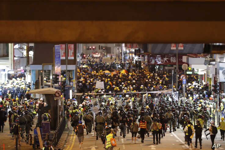 Riot police arrive to disperse protesters at Causeway Bay in Hong Kong, Aug. 4, 2019.