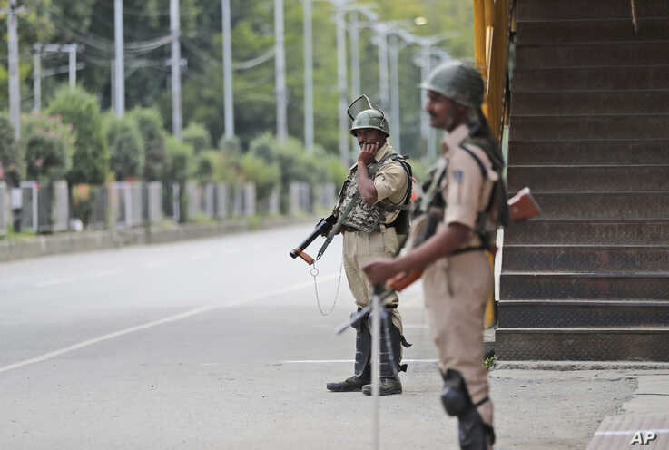 Indian paramilitary soldiers stand guard during a security lockdown in Srinagar, Indian-controlled Kashmir, Aug. 12, 2019.