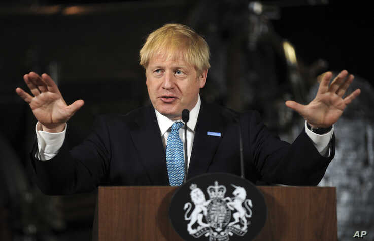 Britain's Prime Minister Boris Johnson gestures during a speech on domestic priorities in Manchester, Britain, July 27, 2019.