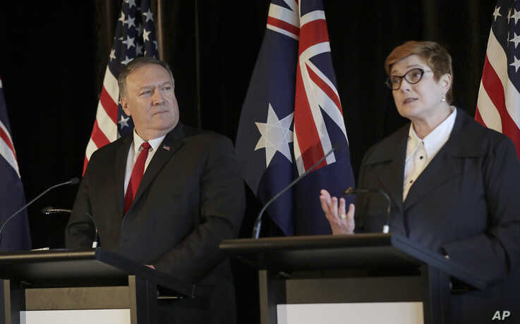 U.S. Secretary of State Mike Pompeo, left, listens as Australian Foreign Minister Marise Payne makes a point during a press conference following annual bilateral talks in Sydney, Australia, Aug. 4, 2019.