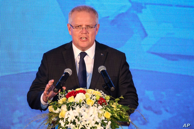 Australian Prime Minister Scott Morrison speaks during his visit to the Hanoi Formula One Grand Prix construction site in Vietnam, Aug. 23, 2019.