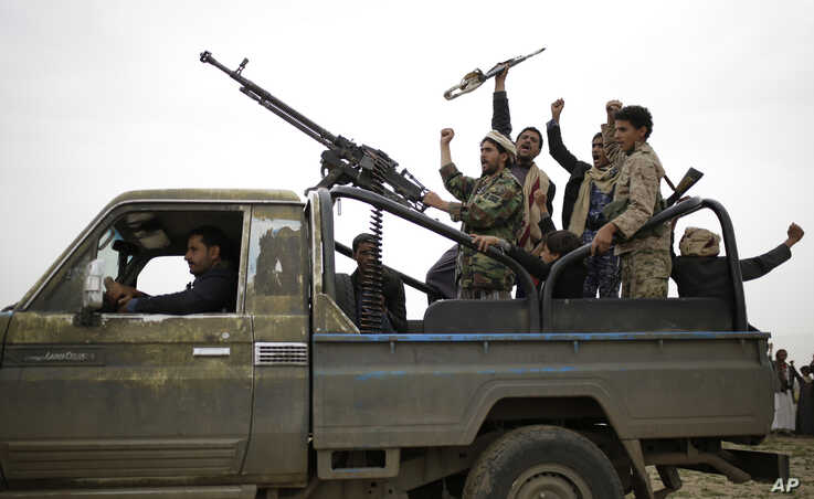 Houthi rebels fighters chant slogans following a gathering aimed at mobilizing more fighters in Sana'a, Yemen, Aug. 1, 2019.
