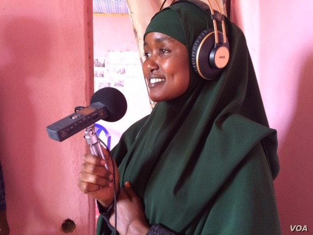 Ikra Dagan is seen rehearsing a script for a podcast, at the Bokolmanyo refugee camp, in Bokolmanyo, Ethiopia. (M. Birungi/VOA)