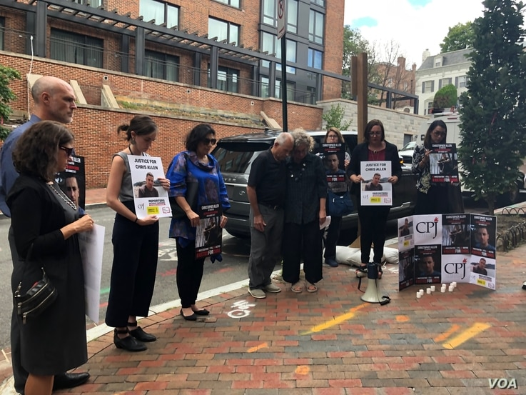 About two dozen people gather for Christopher Allen's two-year memorial, outside the South Sudanese embassy in Washington, Aug. 26, 2019. (A.Bior/VOA)
