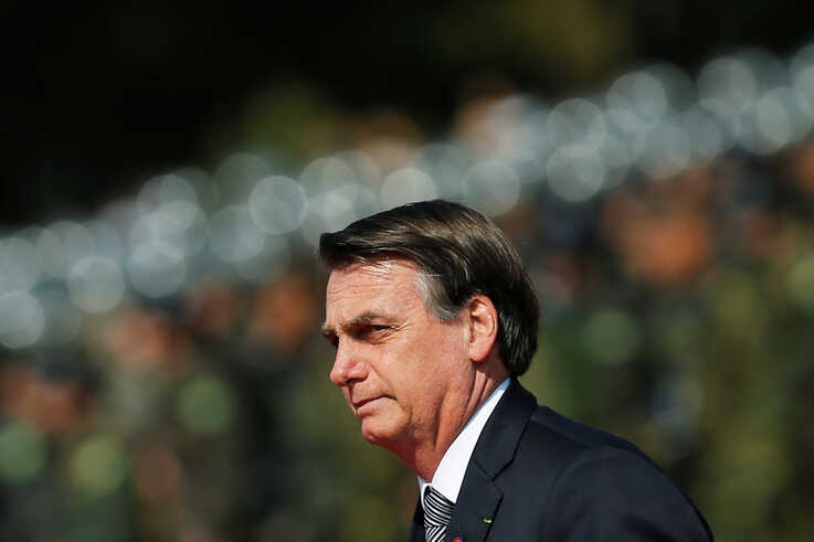 Brazil's President Jair Bolsonaro looks on during an Soldier's Day ceremony, in Brasilia, Brazil, Aug. 23, 2019.