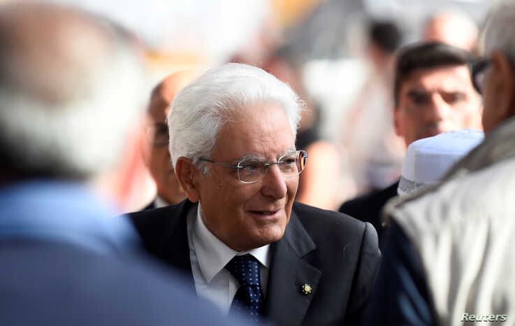 Italian President Sergio Mattarella arrives for the ceremony marking the first anniversary of the collapse of a motorway Morandi Bridge that killed 43 people in Genoa, Aug. 14, 2019.