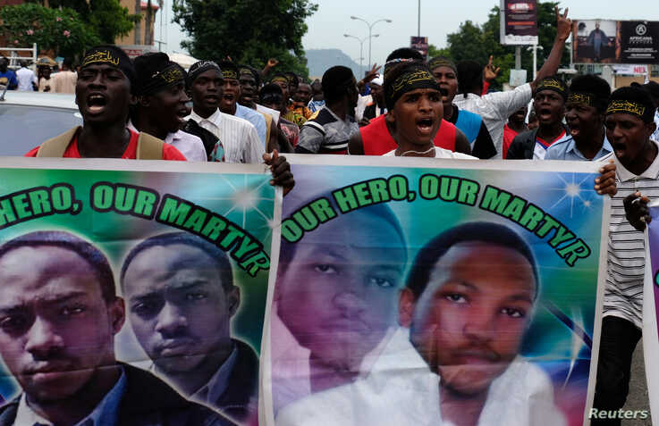 FILE - Members of the Islamic Movement of Nigeria chant slogans during a march to demand the release of their Nigerian Shi'ite leader Ibrahim Zakzaky, along a street in Abuja, Oct. 31, 2018.