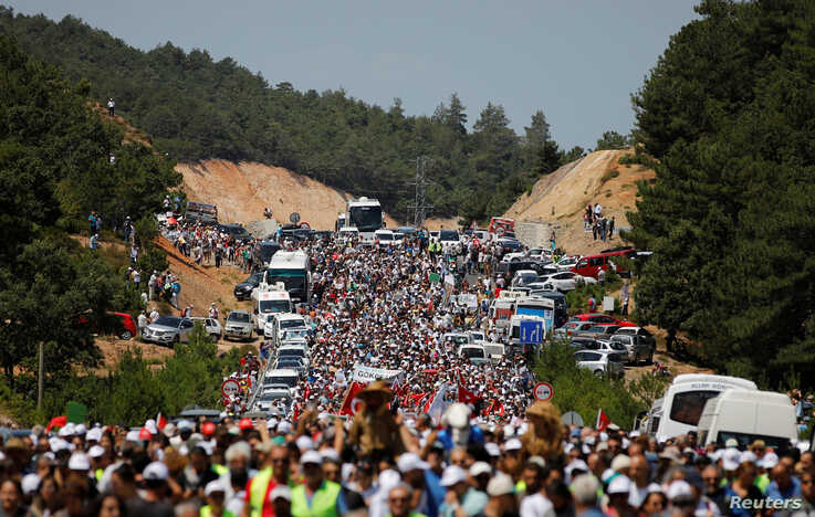 Environmental activists march to protest against what they say will be pollution from a foreign-owned gold mine project near the western town of Kirazli in Canakkale province, Turkey, Aug. 5, 2019.