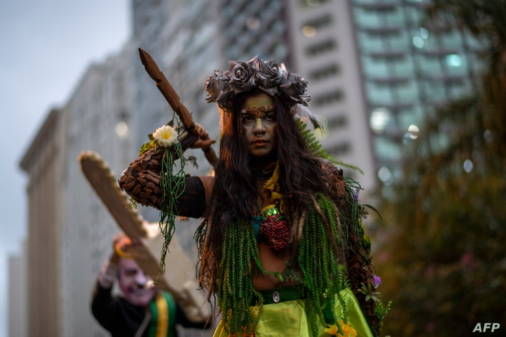 Activists take part in a demonstration against Brazilian President Jair Bolsonaro's environmental policies and the destruction of the Amazon rainforest in Rio de Janeiro, Brazil, Sept. 5, 2019.